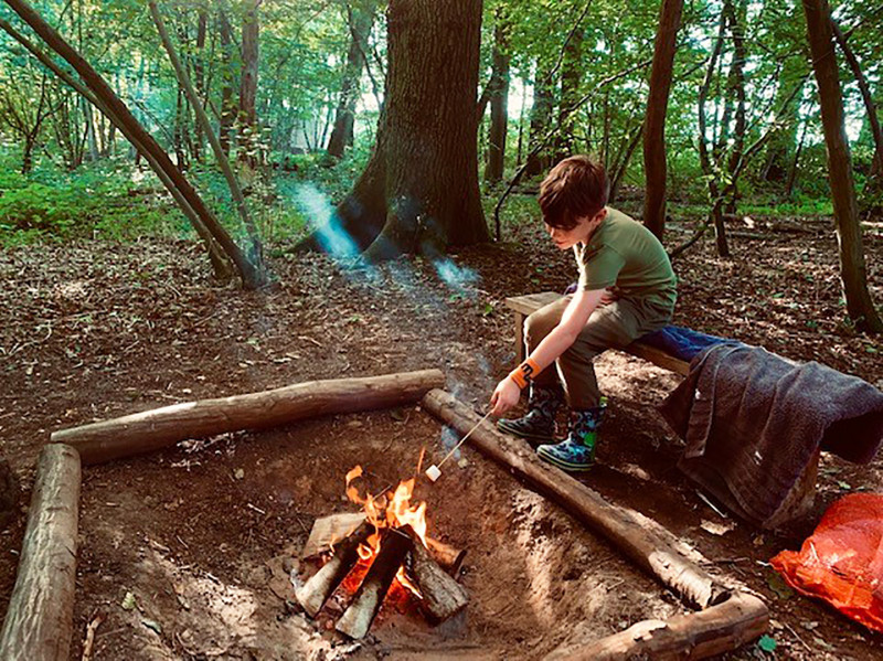Child toasting marshmallow on the campfire